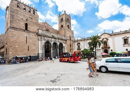 Tourists And Bus On Square Of Duomo In Monreale