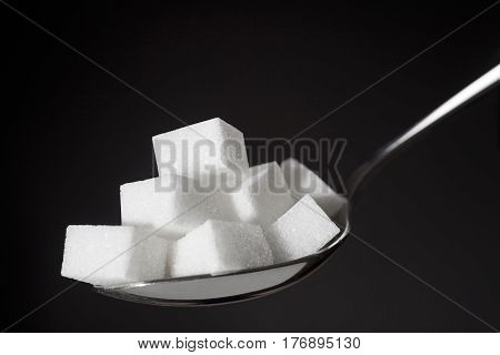 Teaspoon With Pile Of Lump White Sugar