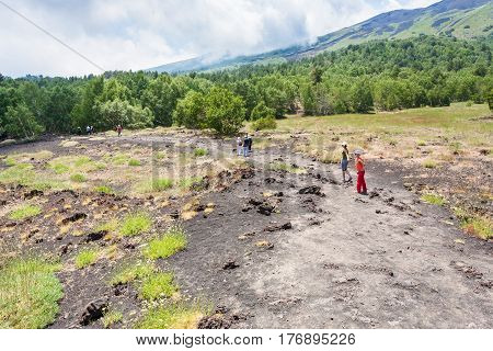 Tourists Walk On Path On Slope Of Etna Mount
