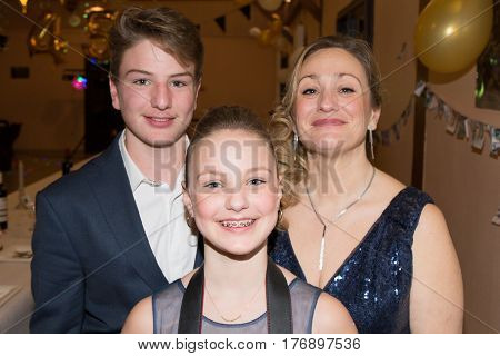Mother With Her Two Teenage Children A Boy And A Girl