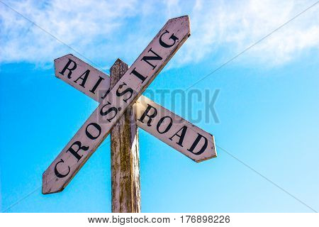Vintage Rail Road Crossing Sign On Weathered Post