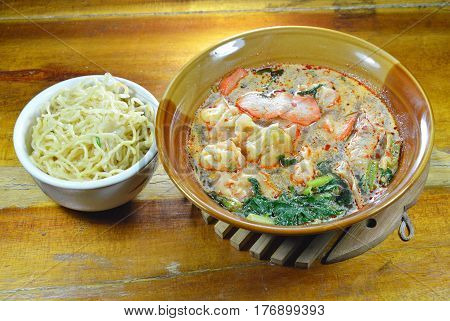 egg noodle and Chinese pork dumpling in spicy soup