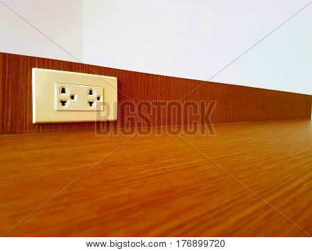 Electric outlet mounted on wooden wall background,White plugs on white wood wall,copy space.