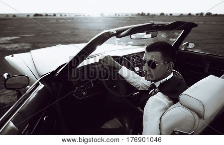 Young representative kind of guy driving a rarity car
