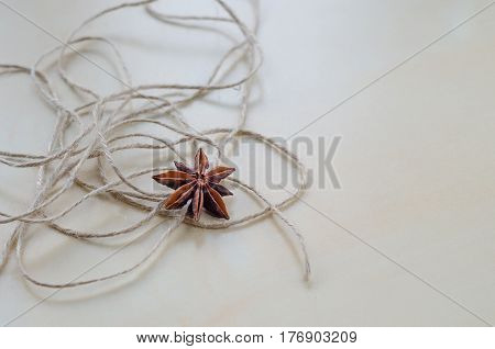 Dried Cloves And Twine On A Wooden Board Closeup