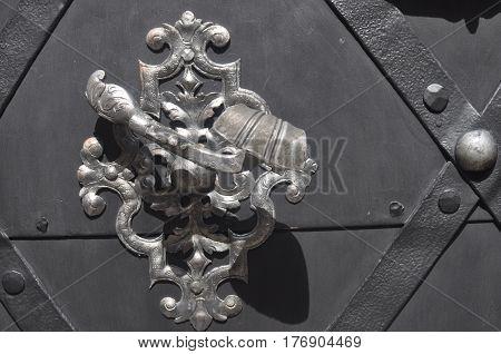 Metal Large Lock Grip on a Gray Door