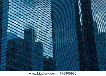Modern Business Office Building Windows with Geometric Lines Sunlight Reflecting