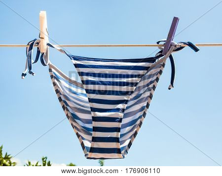 Striped Swimming Panties Is Dried On Clothesline