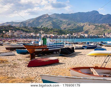 Urban Beach With Boat In Giardini Naxos In Evening