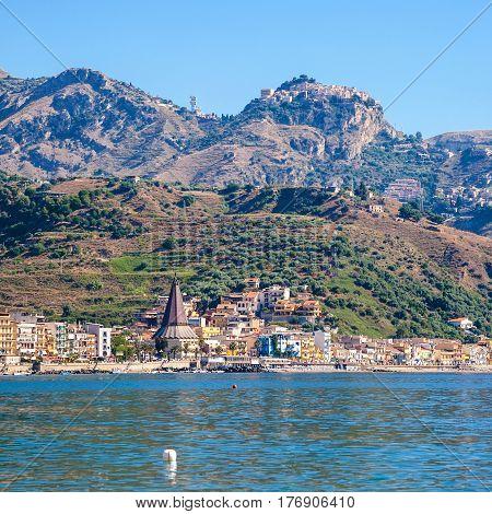 Taormina City On Mountain And Giardini Naxos Town