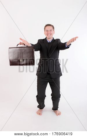 businessman relaxing after work in yoga pose