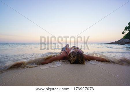 Woman on the beach in Surin Phuket Thailand