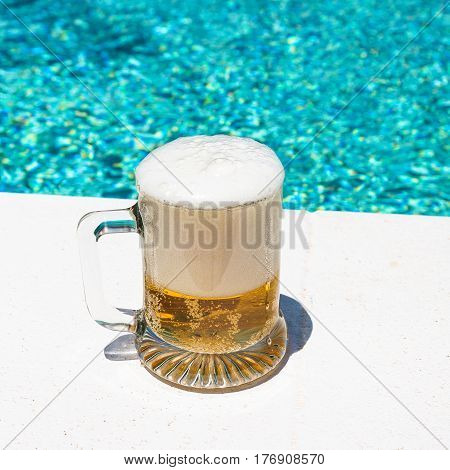 Mug With Cold Light Beer On The Outdoor Pool