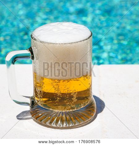 Glass With Cold Light Beer On The Outdoor Pool