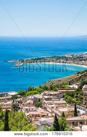 View Of Taormina City And Giardini Naxos Beach