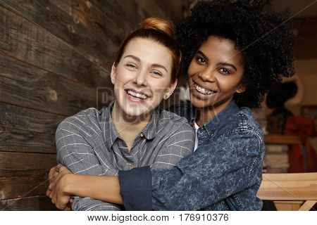 People, Love, Homosexuality And Interracial Relationships Concept. Sweet Shot Of Happy Samesex Femal