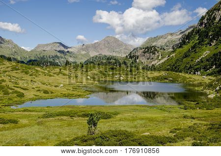 scenic reflection of italian alps over the water of a glacial lake