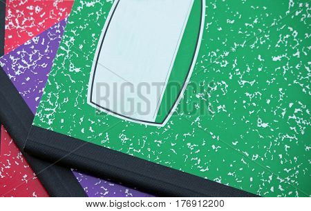 Colorful Composition Notebooks Arranged on a Desk