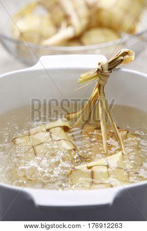 preparing for the hari raya cooking ketupat