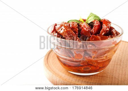 Italian appetizer - sundried tomato in bowl on the wooden board.