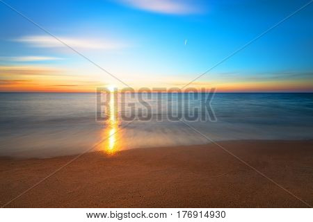 Seascape during sundown. Beautiful natural seascape golden sands.