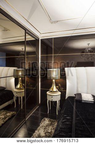Golden lamp Dark bedroom silk velvet luxury contrast interior