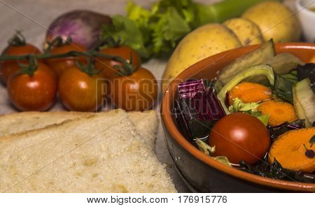 Italian vegetable minestrone soup with potatoes, carrots, onion, potatoes and bread
