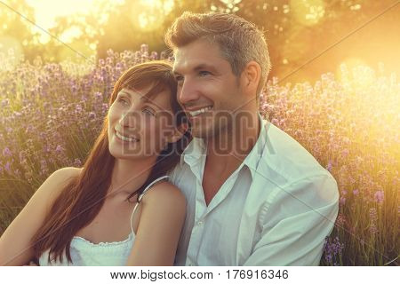 sunset couple relaxing in the color of spring