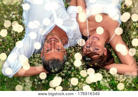 relaxing adult couple toegther in the grass