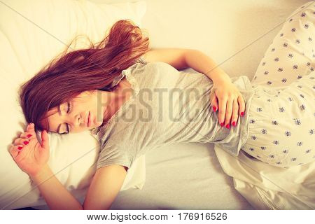 Girl Sleeping In Bed.