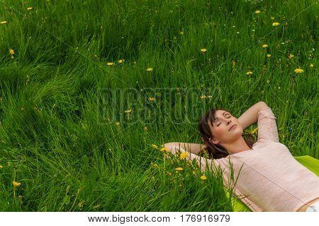 relaxing female lying in high grass