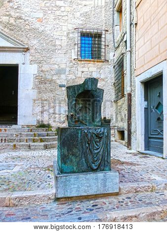 Pals, Girona, Spain - September 15, 2015: The bronze monument of the sculptor Josep Maria Subirachs, dedicated to the builders of the Cathedral of GironaOld town of Pals in Girona, Catalonia at Spain.