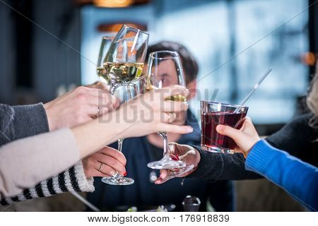 Merry company celebrates victory. Group of people Clink glasses