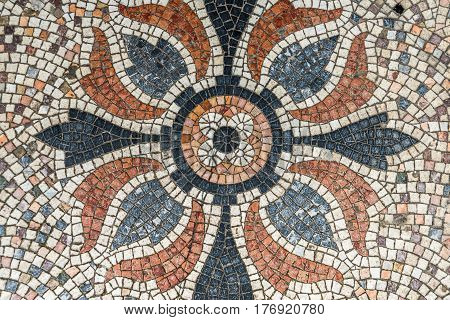 color mosaic in the shape of a flower decorative element on the floor in front of the entrance to the building art decoration