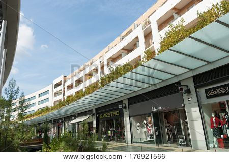 Beziers France - October 6, 2016; Architecture of modern shopping center walkways and modern shop fronts