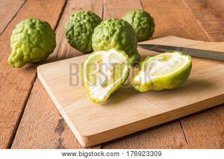 Close up of bergamot or kaffir lime on wooden table background.