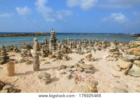 Stone cairns on Baby Beach in Aruba.