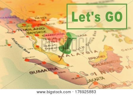 Text LET'S GO and pin on world map background