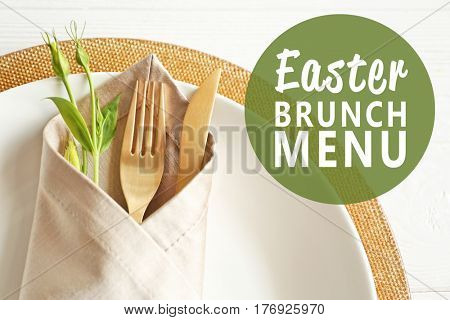 Text EASTER BRUNCH MENU on background. Elegant table setting with floral decor