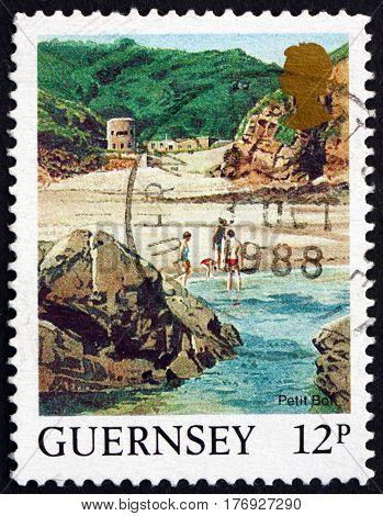 GUERNSEY - CIRCA 1988: a stamp printed in the Guernsey shows Petit Bot Beach Landscape circa 1988