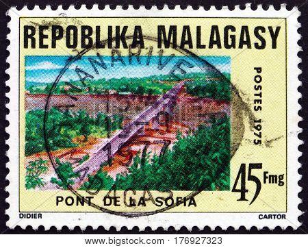 MALAGASY - CIRCA 1975: a stamp printed in Malagasy Madagascar shows Sofia bridge the longest bridge in Madagascar circa 1975