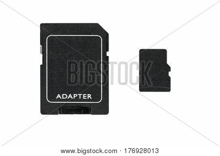 Micro SD card and adapter isolated on a white background with space for your own letters.