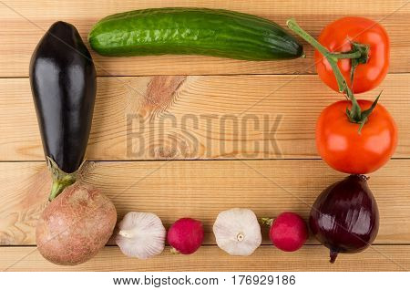 Frame From Different Vegetables On Wooden Table