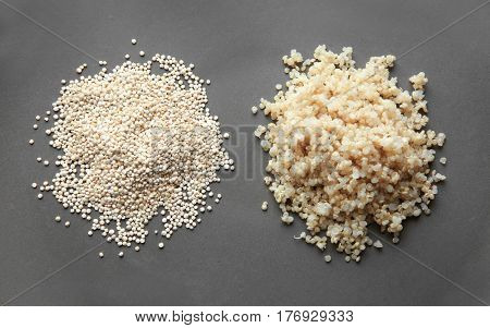 Two heaps of raw and boiled organic white quinoa grains, closeup