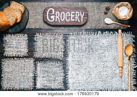 Rustic style template for food and drink industry. Burlap frames on dark wood background with flour pack and sliced bread. Wooden  cutting board with text 'Grocery' as title bar