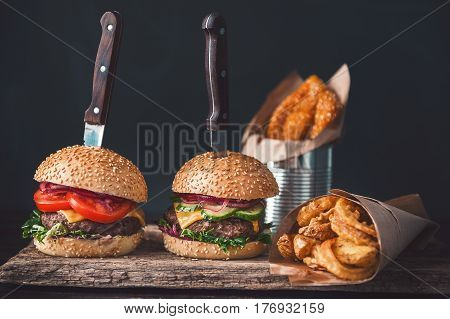 Two Mouth-watering, Delicious Homemade Burger Used To Chop Beef. On The Wooden Table. The Burgers Ar