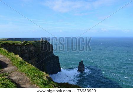 Cliff's of Moher's Needle rock formation and dirt Burren pathway in Ireland.
