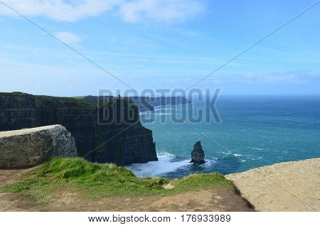 Ireland's needle rock formation with blue skies on the Cliff's of Moher.