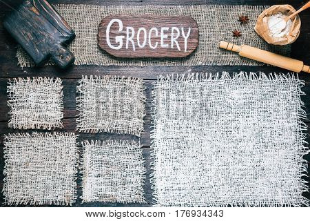 Rustic style template for food and drink industry. Burlap frames on dark wood background with flour pack and baker tools. Wooden  cutting board with text 'Grocery' as title bar