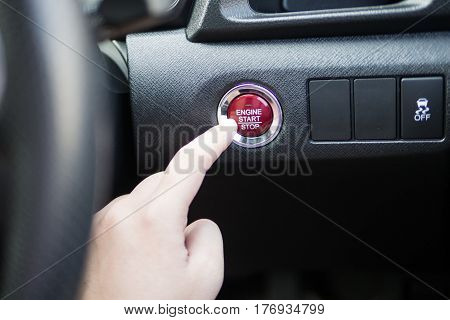 Start/stop engine car button red interior black press by hand to drive